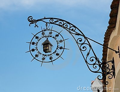 Medieval wrought iron shop sign in shape of lanter