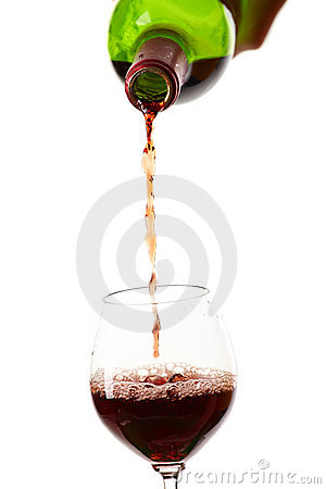 Red wine filling a glass