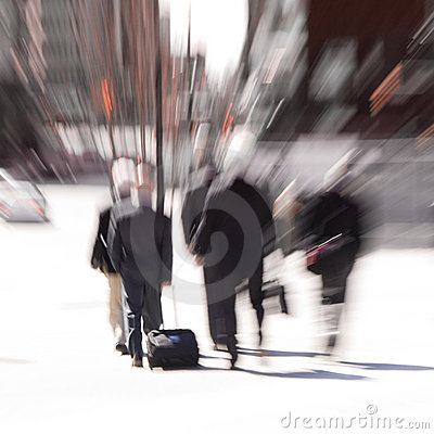 Blur of rushing businessmen