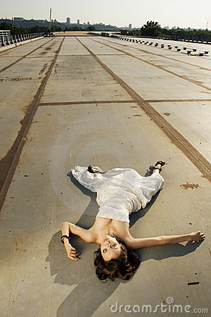 Bride lying on the road