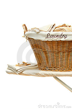 Laundry basket on ironing board against white
