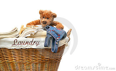 Laundry full of towels with teddy bear