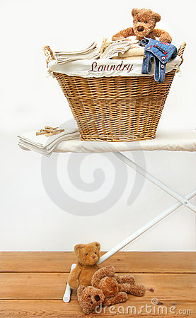 Laundry basket with teddy bears on floor