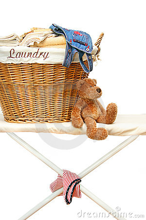 Teddy bear with laundry basket on ironing board