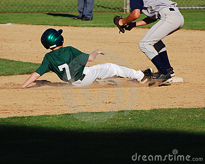 Baseball player sliding into 2nd base.