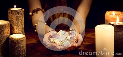 Fortune teller holding healing stones, concept esoteric and life