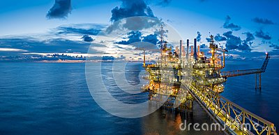Panorama of Oil and Gas central processing platform in twilight, power and energy business.