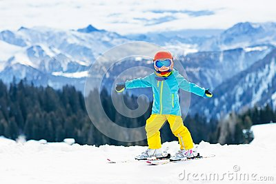 stock image of kids winter snow sport. children ski. family skiing.