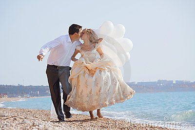 Wedding couple running on beach