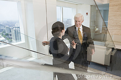 Senior executive in discussion with businesswoman.