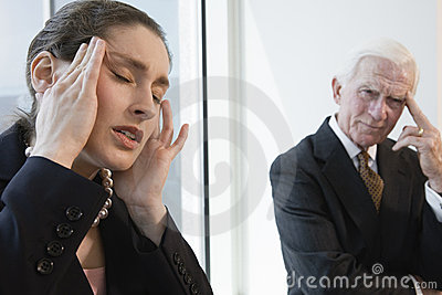 Businesswoman suffering from stress headache.