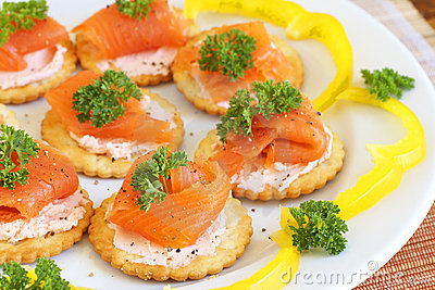 Smoked salmon and cream cheese on crackers