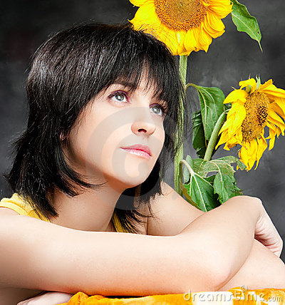 Portrait of a beautiful girl with sunflowers
