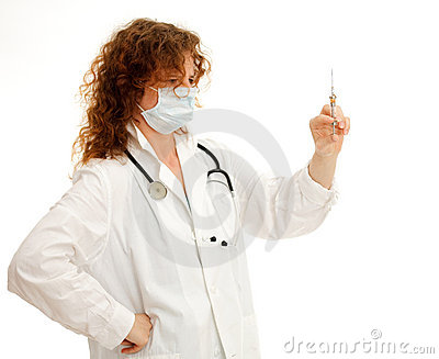 Young nurse in protective mask holding syringe
