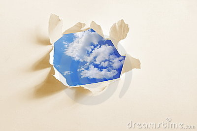 Cloudy sky behind paper hole