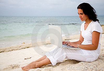 Beach woman with laptop