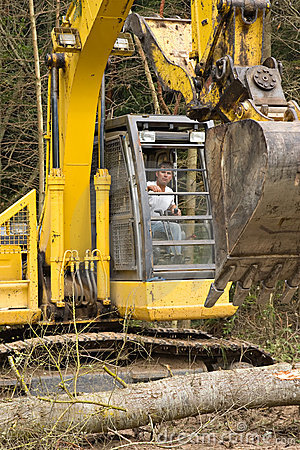 Heavy equipment operator on excavator