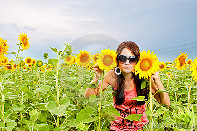 Attractive young girl in  sunflower field