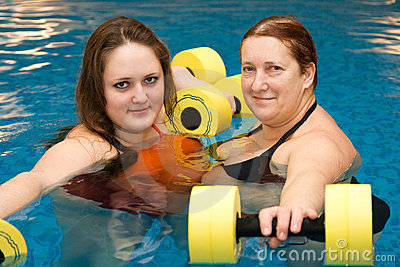 Girl and woman in aqua aerobics