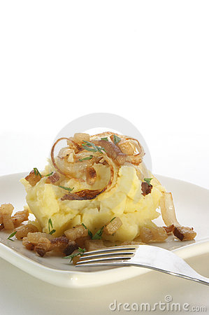 Mashed potato with onion ring and bacon