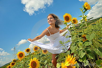 Young woman on field in summer
