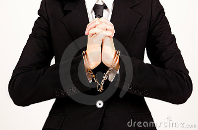Businesswoman handcuffed