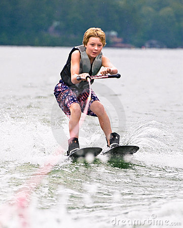 Young Boy on Trick Skis Smiling