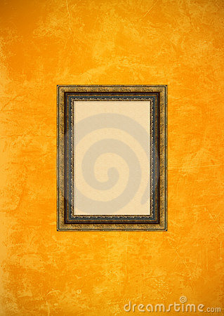 Grunge orange stucco wall with empty picture frame