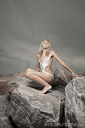 Woman posing on the rocks
