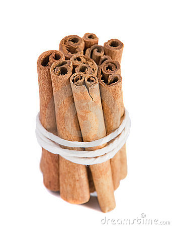 Bundle of cinnamon sticks on the white background.