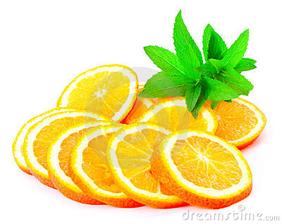 Many sliced oranges and green plant