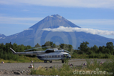 Helicopter at basement of volcano