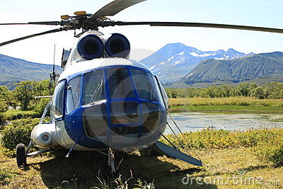 Helicopter with mountains behind it