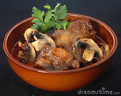 Lamb's tail with mushroom sauce