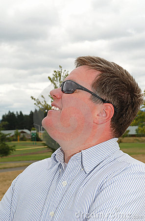 Profile of a happy young man in sunglasses.