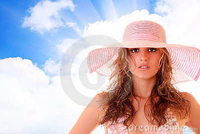 Woman in bikini on the sky background