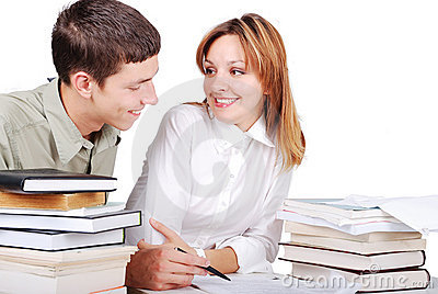 Male and female student learning and helping each