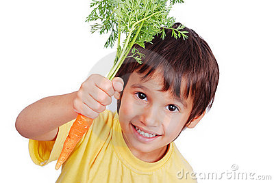 Child with a carrot in hand