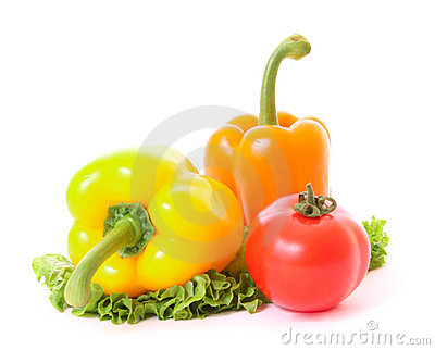 Two peppers and tomato on green salad
