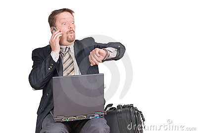 Businessman checking watch