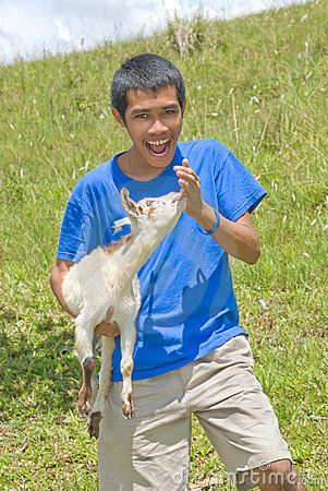 Asian shepherd with young goat