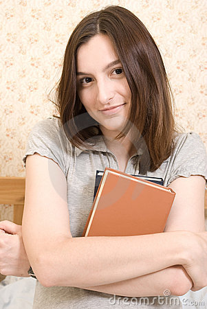 Smiling student with a book