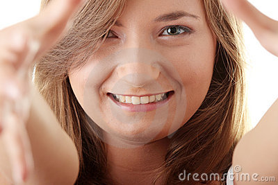 Beautyful young woman framing her face