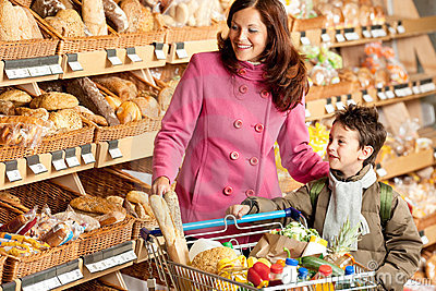 Grocery store - Smiling woman with child