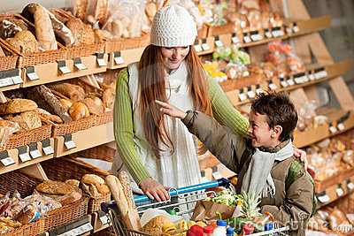 Grocery store - Long red hair woman with child