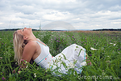 Young woman on a meadow