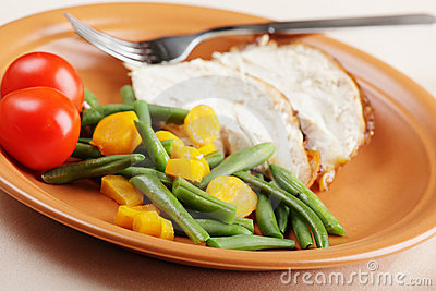 Slices of roasted turkey with vegetables