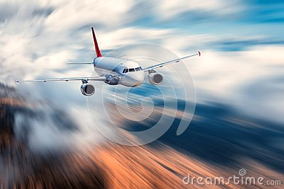 Flying passenger airplane and blurred background