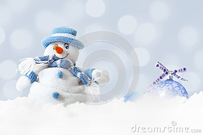 Funny blue snowman on xmas lights bokeh background, white snowflakes, merry Christmas and happy new year card concept