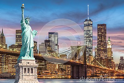 The Statue of Liberty and Brooklyn Bridge with World Trade Center background twilight sunset view, Landmarks of New York City